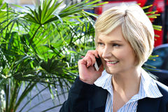 Woman attending a business call Stock Image