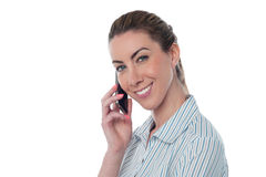 Woman attending business call Stock Image