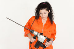Woman with an attitude and a large drill Royalty Free Stock Photos