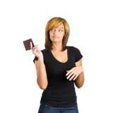 Woman with attitude tossing wallet Royalty Free Stock Image