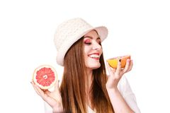 Woman holds two halfs of grapefruit citrus fruit in hands stock images