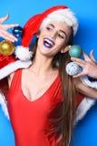 Woman attractive santa celebrate new year. Santa girl christmas party masquerade. Winter exotic vacation. Girl red. Swimsuit and santa hat hold christmas ball stock photos