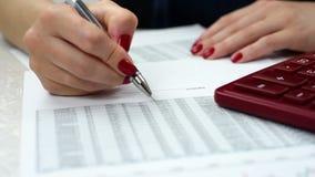 Woman audit financial reports. Businesswoman audit financial reports, extra close up stock footage