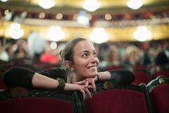 Woman in auditorium of teatre Royalty Free Stock Photography