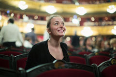 Woman in auditorium of teatre Royalty Free Stock Photo