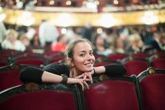 Woman in auditorium of teatre. Portrait of smiling woman in auditorium of opera teatre Stock Images