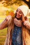 Woman in autumn park holding vitamins medicines stock photo
