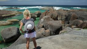 Woman in Australia. Woman with hat on top of Elephant Rocks in William Bay National Park, Denmark, Western Australia. Female traveler in Great Southern Ocean stock video