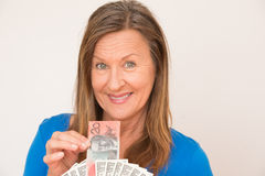 Woman with australian and american dollar Stock Images