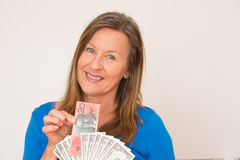 Woman with australian and us dollar Royalty Free Stock Photography