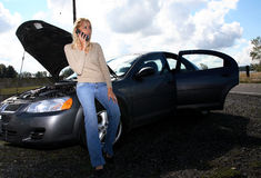 Woman with auto trouble stock image