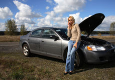 Woman with auto trouble Royalty Free Stock Photo