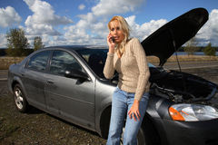 Woman with auto trouble Royalty Free Stock Images