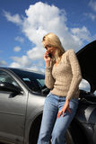 Woman with auto trouble Stock Photography