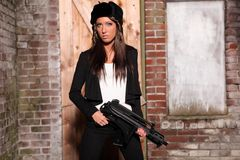 Woman with automatic rifle Stock Images