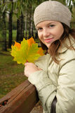 Woman in autumn. Beauty woman holding the leaves in autumn Stock Photos