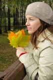 Woman in autumn. Beauty woman holding the leaves in autumn Royalty Free Stock Photo