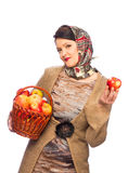 Woman with autumn apples in basket Stock Image