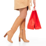 Woman in autumn  boots with shopping bags Stock Image