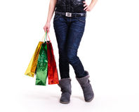 Woman in autumn boots with shopping bags. Royalty Free Stock Image