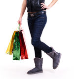 Woman in autumn boots with shopping bags. Royalty Free Stock Photo