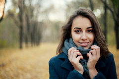 Woman in autumn coat Stock Images