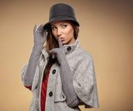 Woman in autumn color. Studio shoot Stock Photos