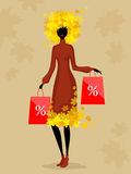 Woman and autumn discounts Royalty Free Stock Image