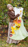 Woman with autumn dress. Costume for the fall. Woman in vintage dress Stock Images