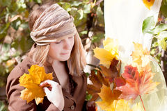 Woman with autumn dress. Woman making a dress for fall Royalty Free Stock Photography
