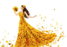 Woman Autumn Fashion Dress of Fall Leaves, Model Girl in Yellow. Wedding Bride Gown on White, Creative Beauty Royalty Free Stock Image
