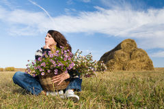 Woman at autumn field Stock Photography