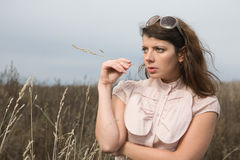 Woman at autumn field Royalty Free Stock Photo