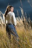 Woman at autumn field Royalty Free Stock Images