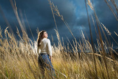 Woman at autumn field Stock Images
