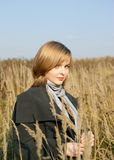 Woman in autumn field with long grass Stock Image