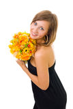 Woman and autumn flowers Stock Photo