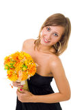 Woman with autumn flowers Stock Image