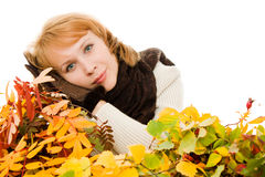 Woman in autumn foliage Stock Image