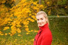 Woman in autumn forest Royalty Free Stock Photos