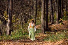 Woman in autumn forest Royalty Free Stock Image