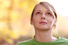 Woman in autumn forest Stock Images