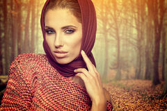 Woman in autumn forest Stock Image