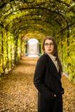 Woman in autumn garden. Young woman in autumn garden Royalty Free Stock Photography