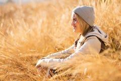 Woman autumn grass Stock Photography