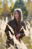 Woman in the autumn grass Stock Images
