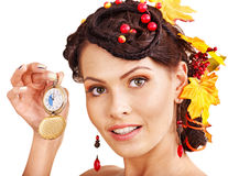 Woman with autumn hairstyle holding clock. Young woman with autumn hairstyle holding clock stock photography