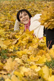 Woman on the autumn leaf Stock Photography