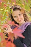 Woman with autumn leaf Royalty Free Stock Photography