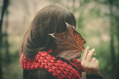 Woman with autumn leaf hide face outdoor royalty free stock photos